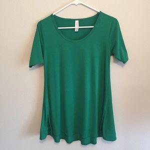 LuLaRoe Green Irma Tunic Top size XXS short sleeve